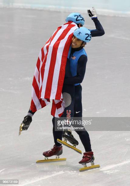 Bronze medalist JR Celski is picked up by silver medalist Apolo Anton Ohno of United States after the 1500 m men's short track on day 2 of the...