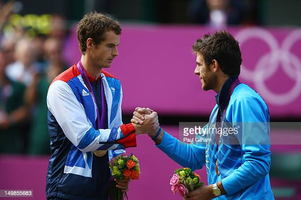 Bronze medalist Juan Martin Del Potro of Argentina congratulates gold medalist Andy Murray of Great Britain during the medal ceremony for the Men's...