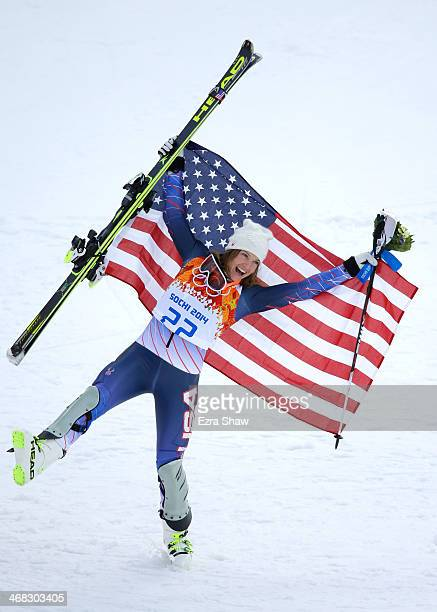 Bronze medalist Julia Mancuso of the United States celebrates after the flower ceremony for the Alpine Skiing Women's Super Combined on day 3 of the...