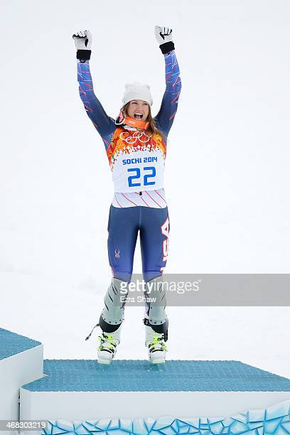 Bronze medalist Julia Mancuso of the United States celebrates during the flower ceremony for the Alpine Skiing Women's Super Combined on day 3 of the...