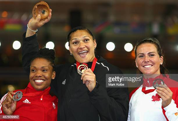 Bronze medalist Julie Labonte of Canada Gold medalist Valerie Adams of New Zealand and silver medalist Cleopatra Borel of Trinidad and Tobago pose on...