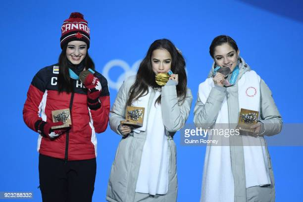 Bronze medalist Kaetlyn Osmond of Canada gold medalist Alina Zagitova of Olympic Athlete from Russia and silver medalist Evgenia Medvedeva of Olympic...