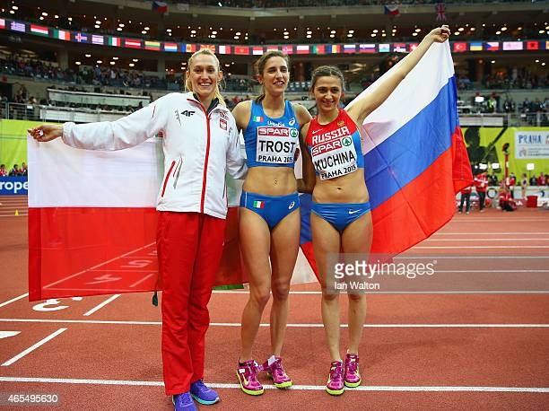 Bronze medalist Kamila Licwinko of Poland silver medalist Alessia Trost of Italy and gold medalist Mariya Kuchina of Russia pose after the Women's...