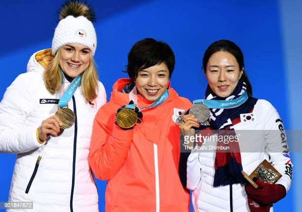 Bronze medalist Karolina Erbanova of the Czech Republic gold medalist Nao Kodaira of Japan and silver medalist Lee Sanghwa of South Korea celebrate...
