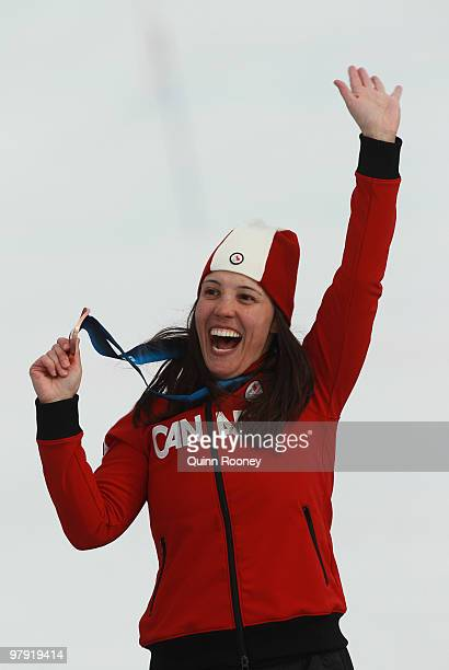 Bronze medalist Karolina Wisniewska of Canada celebrates at the medal ceremony for the Women's Standing Super Combined during Day 9 of the 2010...