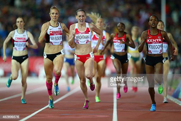 Bronze medalist Kate van Buskirk of Canada Silver medalist Laura Weightman of England and gold medalist Faith Kibiegon of Kenya sprint to finish line...