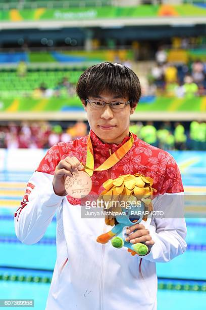 Bronze medalist Keichi Nakajima of Japan celebrates on the podium at the medal ceremony for the Men's 200m IM SM14 Final on day 10 of the Rio 2016...