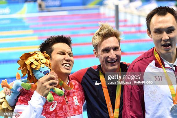 Bronze medalist Keiichi Kimura of Japan celebrates on the podium at the medal ceremony for the Men's 100m Freestyle S11 Final on day 8 of the Rio...
