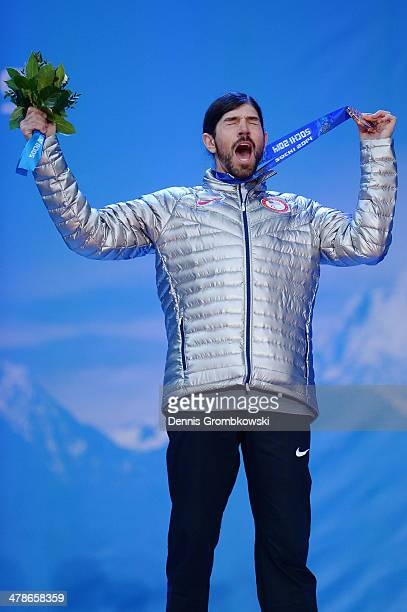 Bronze medalist Keith Gabel of the United States celebrates during the medal ceremony for Men's Snowboard Cross Standing on day seven of the Sochi...