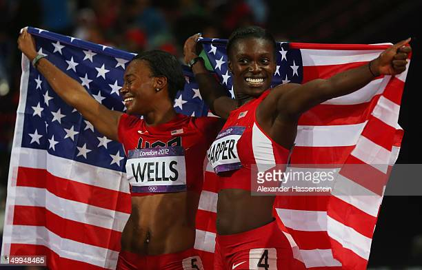 Bronze medalist Kellie Wells and silver medalist Dawn Harper of the United States celebrate after the Women's 100m Hurdles Final on Day 11 of the...