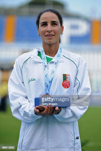 Bronze medalist Kenza Dahmani Eps Tifani of Algeria poses for the photographers after the Women's 1/2 Marathon Final during the XVI Mediterranean...