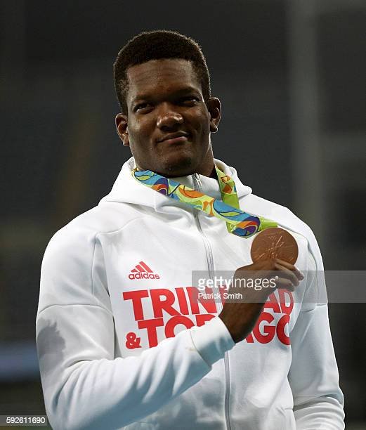 Bronze medalist Keshorn Walcott of Trinidad and Tobago stands on the podium during the medal ceremony for the Men's Javelin Throw on Day 15 of the...