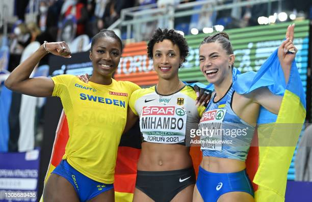 Bronze medalist Khaddi Sagnia of Sweden, silver medalist Malaika Mihambo of Germany and gold medalist Maryna Bekh-Romanchuk of Ukraine pose for a...