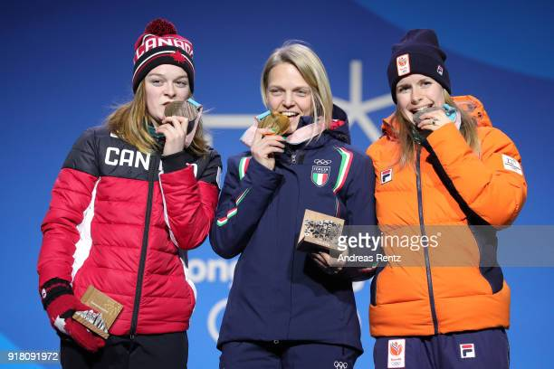 Bronze medalist Kim Boutin of Canada gold medalist Arianna Fontana of Italy and Silver medalist Yara Van Kerkhof of the Netherlands pose during the...