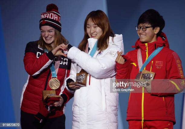 Bronze medalist Kim Boutin of Canada gold medalist Minjeong Choi of Korea and silver medalist Jinyu Li of China celebrate during the victory ceremony...