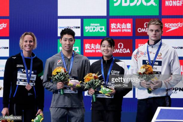 Bronze medalist Kosuke Hagino of Japan smiles during the medal ceremony after the Men's 200m Individual Medley on day two of the FINA Swimming World...