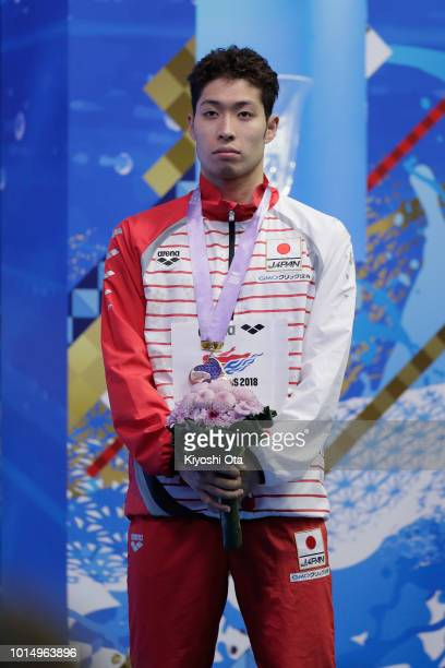 Bronze medalist Kosuke Hagino of Japan stands on the podium at the medal ceremony for the Men's 200m Individual Medley on day three of the Pan...