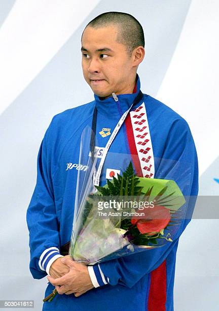 Bronze medalist Kosuke Kitajima of Japan bites his lip at the medal ceremony for the Men's 100m Breaststroke final during day two of the Pan Pacific...