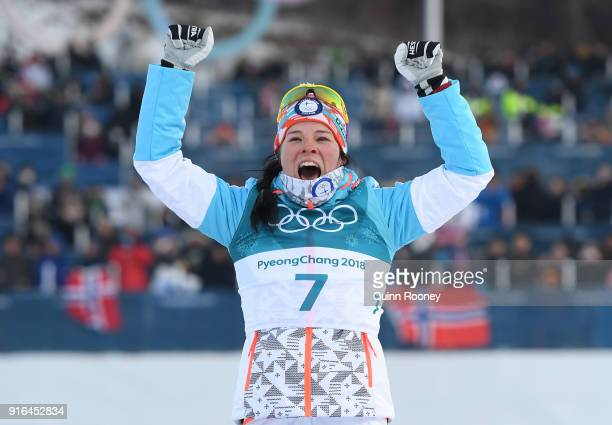 Bronze medalist Krista Parmakoski of Finland poses during the victory ceremony for the Ladies Cross Country Skiing 75km 75km Skiathlon on day one of...