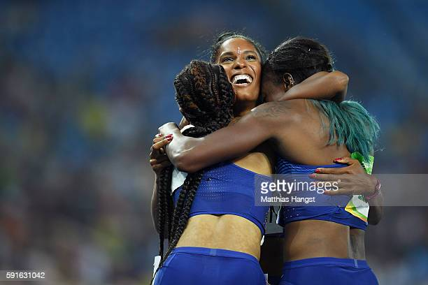 Bronze medalist Kristi Castlin celebrates with gold medalist Brianna Rollins and silver medalist Nia Ali of the United States after the Women's 100m...