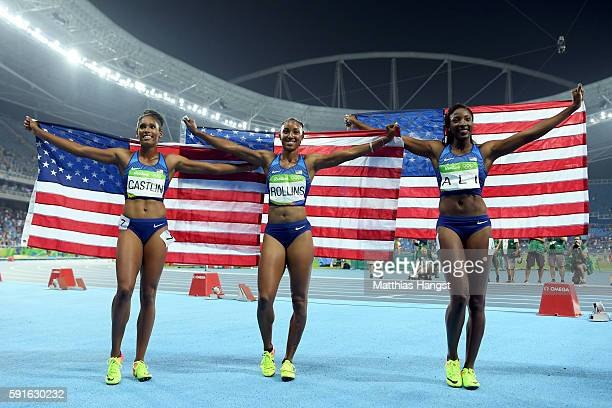 Bronze medalist Kristi Castlin gold medalist Brianna Rollins and silver medalist Nia Ali of the United States celebrate with American flags after the...