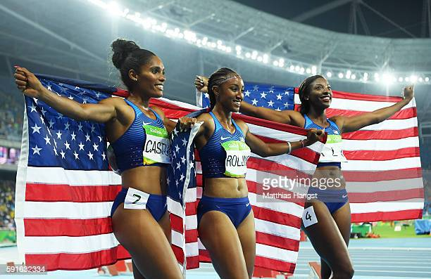 Bronze medalist Kristi Castlin gold medalist Brianna Rollins and silver medalist Nia Ali of the United States pose with American flags after the...