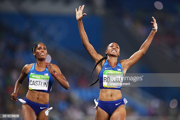Bronze medalist Kristi Castlin of the United States and gold medalist Brianna Rollins of the United States celebrate as they finish the Women's 100m...