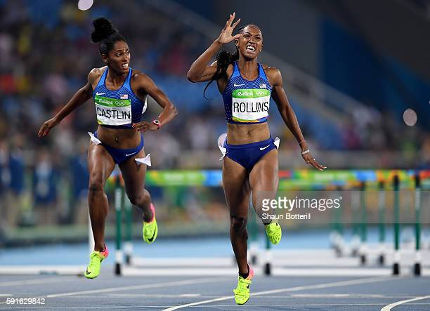 Bronze medalist Kristi Castlin of the United States and gold medalist Brianna Rollins of the United States react as they finish the Women's 100m...