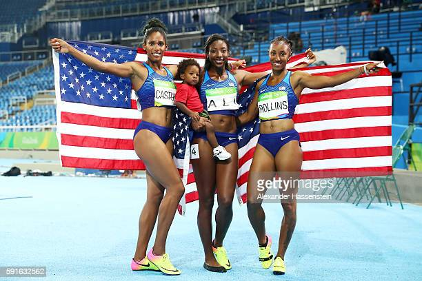 Bronze medalist Kristi Castlin silver medalist Nia Ali and gold medalist Brianna Rollins of the United States pose with Ali's son Titus after the...