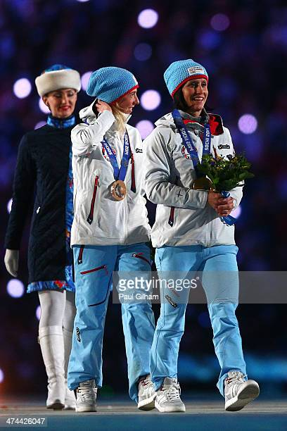 Bronze medalist Kristin Stoermer Steira of Norway and gold medalist Marit Bjoergen of Norway celebrate during the medal ceremony for the Women's 30...