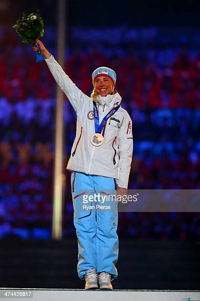 Bronze medalist Kristin Stoermer Steira of Norway celebrates in the medal ceremony for the Women's 30 km Mass Start Free during the 2014 Sochi Winter...