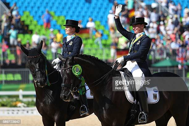 Bronze medalist Kristina BroringSprehe of Germany riding Desperados Frh and silver medalist Isabell Werth of Germany riding Weihegold Old celebrate...
