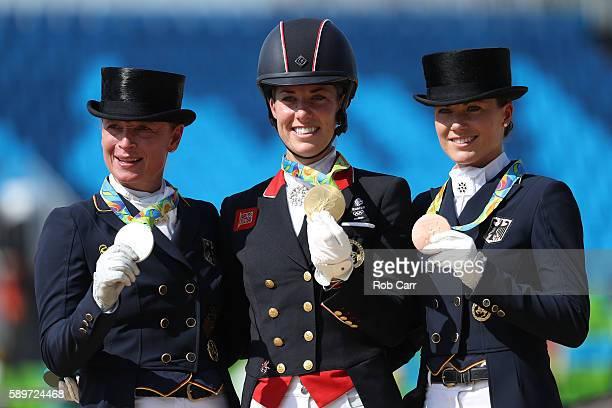 Bronze medalist Kristina BroringSprehe of Germany riding Desperados Frh gold medalist Charlotte Dujardin of Great Britain riding Valegro and silver...