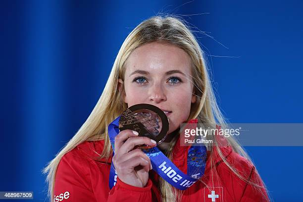 Bronze medalist Lara Gut of Switzerland celebrates during the medal ceremony for the Alpine Skiing Women's Downhill on day five of the Sochi 2014...