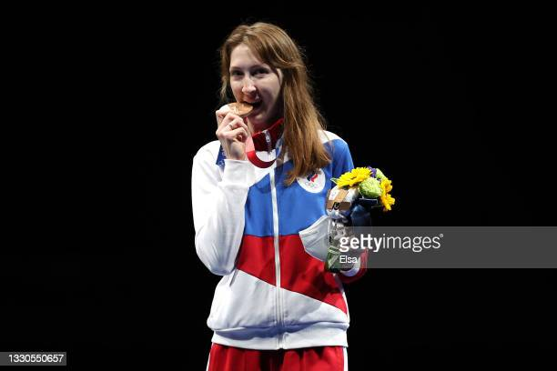 Bronze medalist Larisa Korobeynikova of Team ROC poses with her medal on the podium during the medal ceremony for the Women's Foil Individual Fencing...