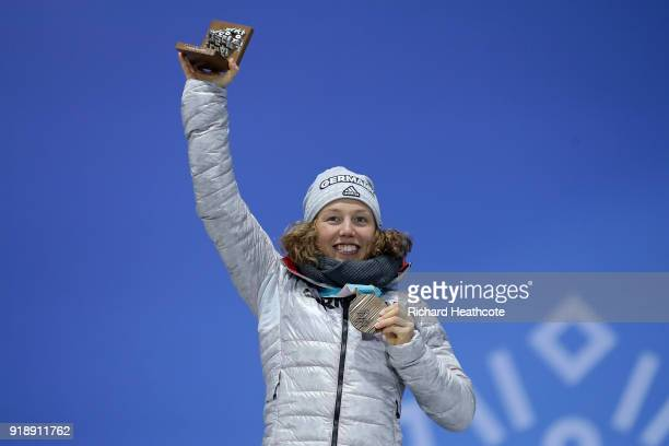 Bronze medalist Laura Dahlmeier of Germany celebrates during the Medal Ceremony for Biathlon Women's 15km Individual on day seven of the PyeongChang...