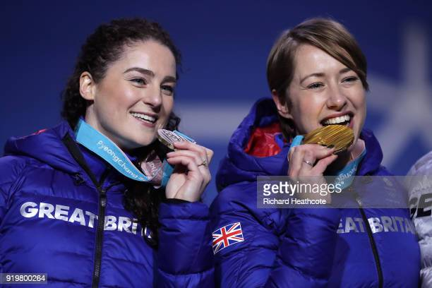 Bronze medalist Laura Deas of Great Britain and gold medalist Lizzy Yarnold of Great Britain celebrate during the medal ceremony for the Women's...