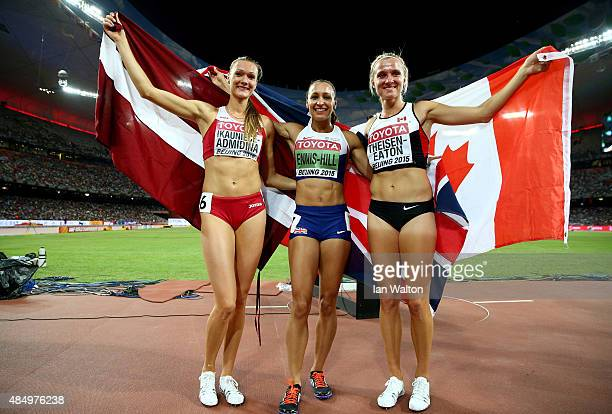 Bronze medalist Laura Ikauniece-Admidina of Latvia, gold medalist Jessica Ennis-Hill of Great Britain and silver medalist Brianne Theisen Eaton of...