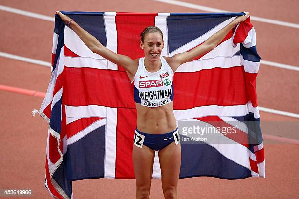 Bronze medalist Laura Weightman of Great Britain and Northern Ireland celebrates with a Union Jack after the Women's 1500 metres final during day...