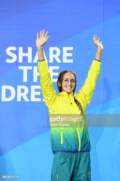 Bronze medalist Leiston Pickett of Australia waves during the medal ceremony for the Women's 50m Breaststroke Final on day two of the Gold Coast 2018...