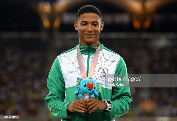 Bronze medalist Leon Reid of Northern Ireland looks on during the medal ceremony for the Men's 200 metres during athletics on day nine of the Gold...