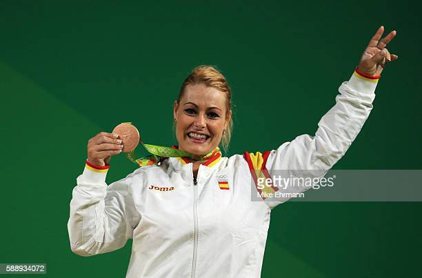 Bronze medalist Lidia Valentin Perez of Spain celebrates on the podium during the medal ceremony for the Weightlifting Women's 75kg on Day 7 of the...
