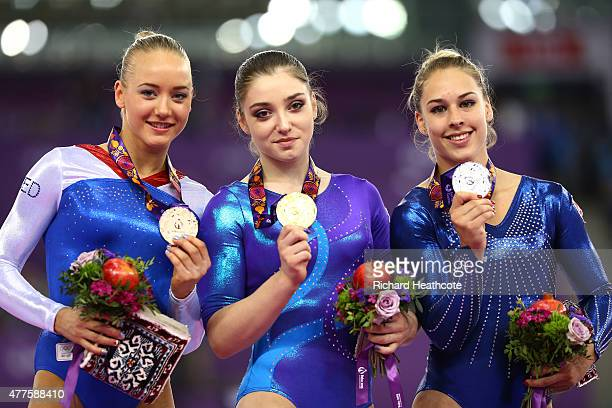 Bronze medalist Lieke Wevers of Netherlands gold medalist Aliya Mustafina of Russia and Silver medalist Giulia Steingruber of Switzerland pose with...