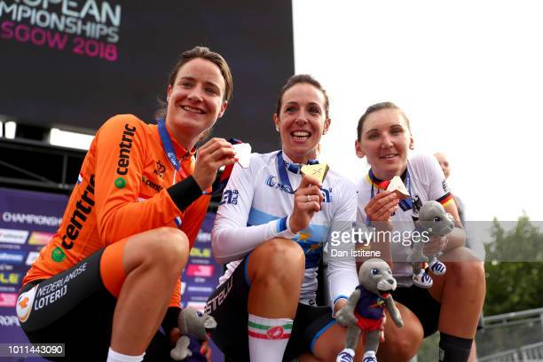 Bronze medalist Lisa Brennauer of Germany Silver medalist Marianne Vos of the Netherlands and Gold medalist Marta Bastianelli of Italy pose with...