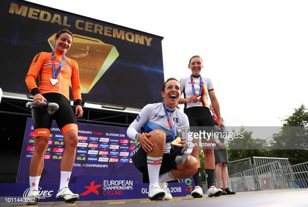 Bronze medalist Lisa Brennauer of Germany Silver medalist Marianne Vos of the Netherlands and Gold medalist Marta Bastianelli of Italy celebrate with...