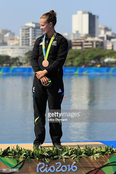 Bronze medalist Lisa Carrington of New Zealand stands on the podium during the medal ceremony for the Women's Kayak Single 500m event at the Lagoa...
