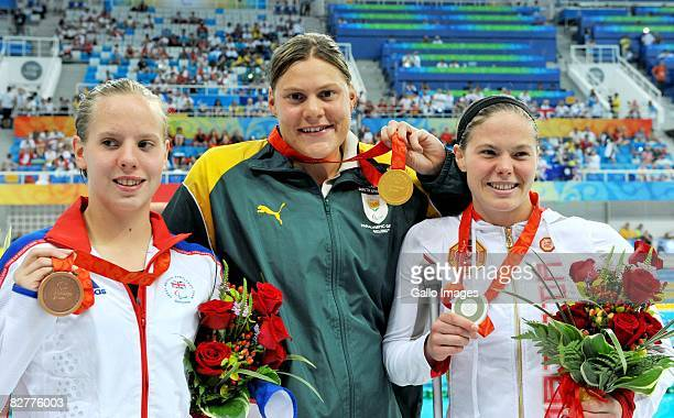 Bronze medalist Louise Watkin of Great Britain gold medalist Natalie du Toit of South Africa and silver medalist Stephanie Dixon of Canada after the...