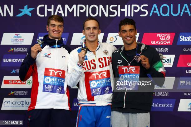 Bronze medalist Luca Pizzini of Italy Silver medalist James Wilby of Great Britain and Gold medalist Anton Chupkov of Russia pose with their medals...