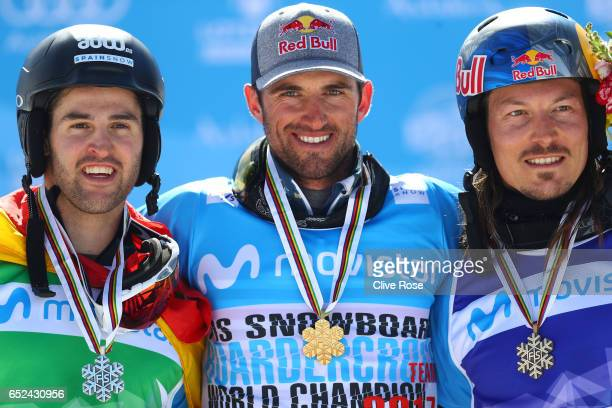 Bronze medalist Lucas Eguibar of Spain gold medalist Pierre Vaultier of France and bronze medalist Alex Pullin of Australia pose during the medal...
