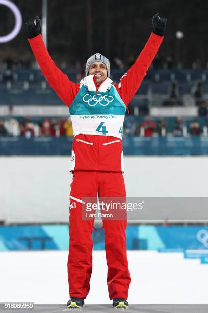 Bronze medalist Lukas Klapfer of Austria celebrates on the podum during the victory ceremony for the Nordic Combined Individual Gundersen Normal Hill...